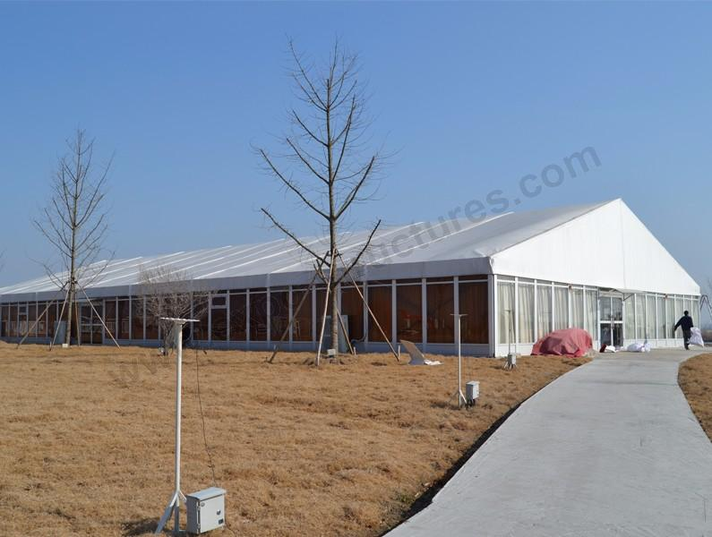 Outdoor marquee tent with glass panel wall